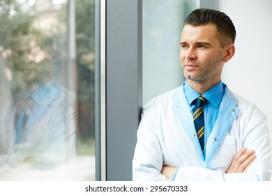 Dentist Doctor Stands Near Window and Thinks about Clinic Future