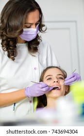 Dentist exam of young teen girl in dentist office