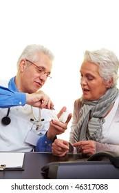 Dentist explaining dental prints to his patient
