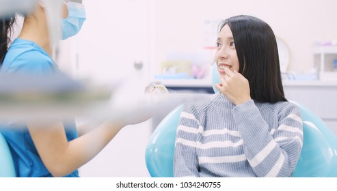 Dentist explaining the implant tooth to the patient