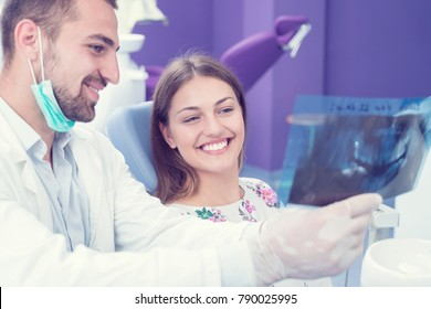 Dentist explaning oral x ray to patient. concept