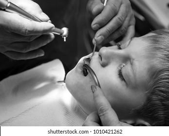 dentist heals the teeth of caucasian boy