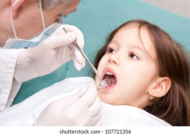 at the dentist - little girl have a consultation