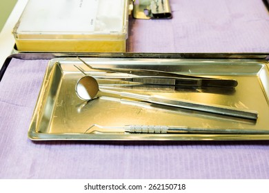 Dentist main equipment and tools on tray consist of mirror and scraper