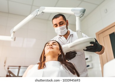 Dentist making x-ray for the female patient in the clinic