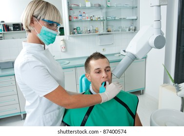 dentist making x-ray image of patient teeth