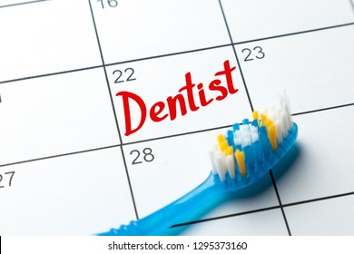 Dentist note on the calendar. Toothbrush and calendar entry
