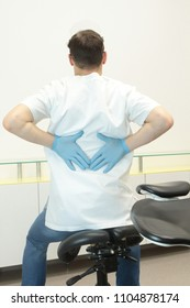 Dentist with pain in back exercising