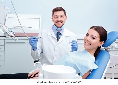 Dentist with patient in clinic