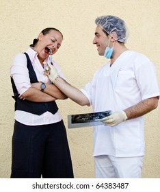 The dentist and patient joke scene depicting a tooth extraction.