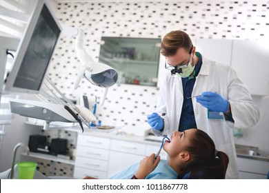 Dentist repairing females tooth on dental clinic