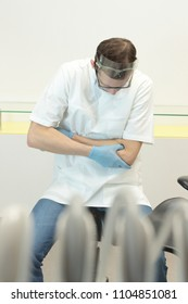 Dentist suffering from elbow pain -occupational disease