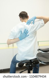 Dentist suffering from shoulder, back  pain - occupational disease
