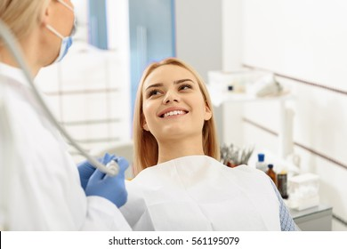 Dentist taking care of painful tooth