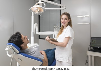 Dentist talking with a patient