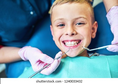 dentist treating his teeth and filling cavity in modern clinic