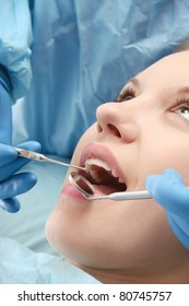 The dentist is treating teeth of the patient - close-up portrait