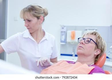 The dentist treats teeth