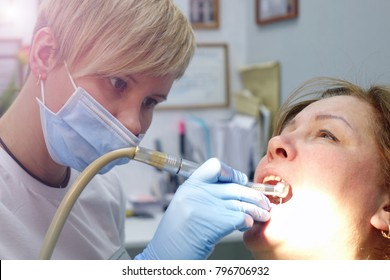 Dentist at work in the office. Treatment teeth.