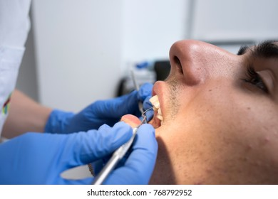 Dentist working with patient. close up.
