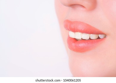 Dentistry, healthy perfect white teeth. Adorable beautiful smile of young woman, close up.