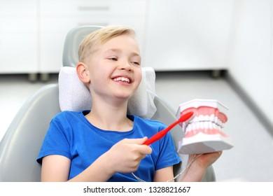 Dentistry, a joyful child in a dental chair