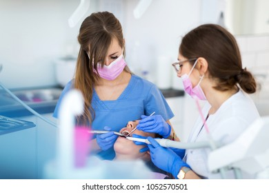 Dentists and patient in dentist office