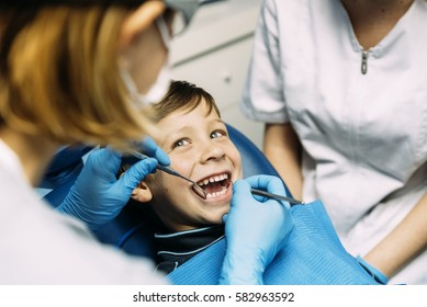 Dentists with a patient during a dental intervention to boy. Dentist  Concept