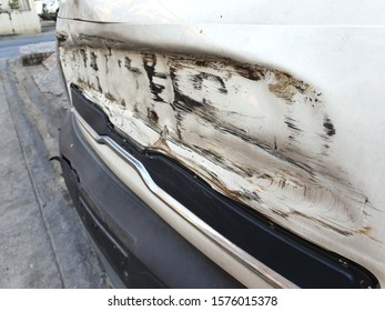 The dents on the car caused by the accident