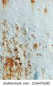 Dents, scrapes and long exposure to salt water producing rust and paint bubbles on commercial fishing boat hull
