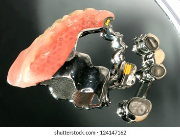 Denture from the laboratory on the mirror with reflection