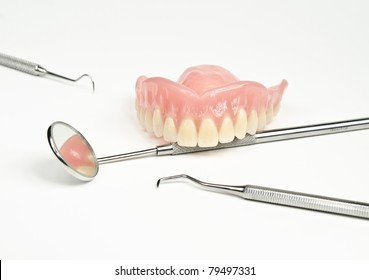 denture with medical tools