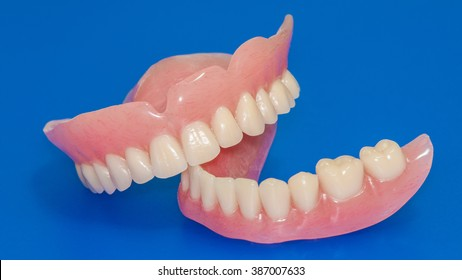 Denture on a blue background