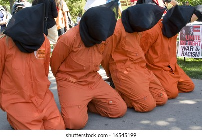 DENVER - AUGUST 25: Masked Guantanamo protesters kneel during the Democratic National Convention August 25, 2008 in Denver.