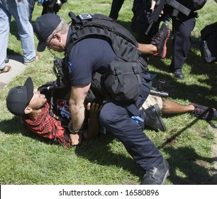 DENVER - AUGUST 26: A police officer tackles and arrests a protester during the Democratic National Convention August 26, 2008 in Denver.