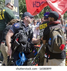 DENVER - AUGUST 26: A police officer talks to a protester during the Democratic National Convention August 26, 2008 in Denver.