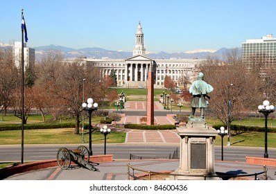 Denver City hall (City and County Building) viewed from Colorado State Capital, Civil War memorial in foreground, Spring.