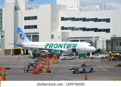 DENVER, CO -11 MAY 2019- View of an airplane from Frontier Airlines (F9) at the Denver International Airport, or DIA (DEN), at the foot of the Rocky Mountains.
