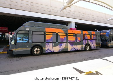 DENVER, CO -11 MAY 2019- View of a bus at the Denver International Airport, or DIA (DEN), a major hub for United Airlines and Frontier Airlines located at the foot of the Rocky Mountains.