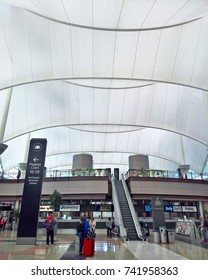 DENVER, CO - APRIL 23, 2016: The fabric roof structure of Denver International Airport, DEN, and its peak forms were designed to mimic the Rocky Mountains in Colorado. The airport opened in Feb 1995.