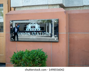 DENVER, CO JULY 16, 2018: Denver Union Station sign outside of entrance with people walking in