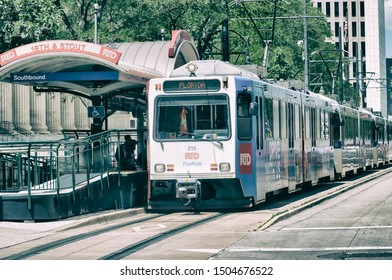 DENVER, CO - JULY 3, 2019: City tram on a beautiful summer day. Denver is the main city of Colorado.