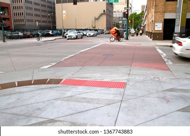 Denver, CO - May 25 2016: A crosswalk and curb extension on 14th Street in downtown Denver
