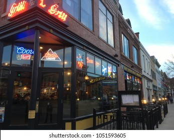 Denver, CO, USA - 12 November 2017: Facade of the Capitol Grill, an upscale steakhouse chain in the Central Business District of Denver, Colorado. Tables and chairs set out for outdoor dining.