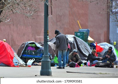Denver, CO, USA, April 19, 2020. Unidentified homeless people camping out and living on the streets in Downtown Denver because the homeless shelters are no longer safe due to the Coronavirus.