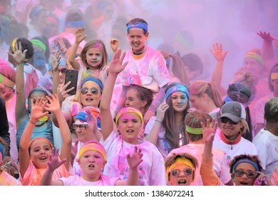 Denver, CO, USA, April 24, 2016. Participants in the 5K Graffiti Run. Cannons shoot out colored powder at the runners. This is a yearly fund raising special event in Denver.