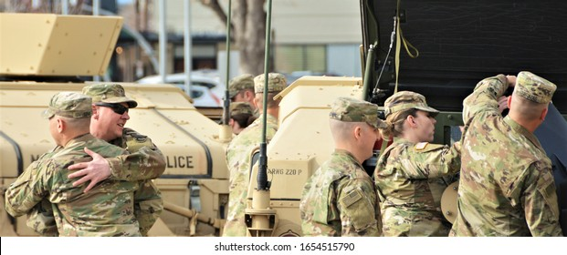 Denver, CO, USA. Feb 22, 2020. Unidentified Colorado National Guard Military Police Unit, U.S. Army soldiers at a going away ceremony before they deploy overseas for 6 months.