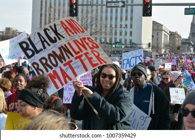 Denver, CO, USA, Jan 20,2018, Woman's march in Colorado is for solidarity for social justice, human rights and equality for women. People holding up a Black and Brown lives matter protest sign.