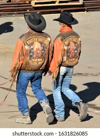 Denver, Co, USA. Jan 21, 2020. Unidentified couple with matching  leather Yosemite Sam jackets walking instep together at a Western outdoor event in Denver.