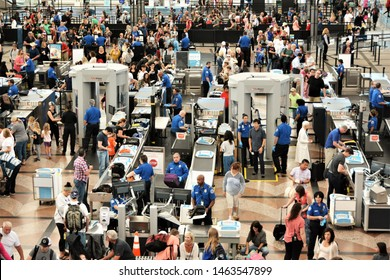 Denver, CO, USA. July 27, 2019. Travelers in long lines at Denver International Airport going thru the Transportation Security Administrations (TSA) security screening areas to get to their flights.